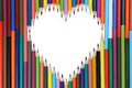 Colored pencils forming a heart love topic Royalty Free Stock Photo