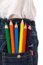 Colored pencils in kids jeans pocket Royalty Free Stock Images