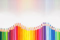 Colored pencils in rainbow order on white background. Royalty Free Stock Photo