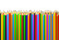 Colored pencils in a row abstract background Royalty Free Stock Image
