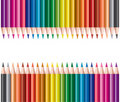 Colored pencils in rows Stock Image