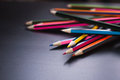Colored pencils scattered on the Desk Royalty Free Stock Photo