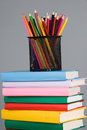 Colored pencils and a stack of books Royalty Free Stock Photos
