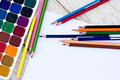 Colored pencils, water colors and paper Royalty Free Stock Photo
