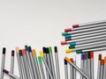 Colored pencils on white background multi a Stock Image