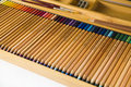 Colored pencils in a wooden box Stock Image