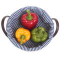 Colored pepper on basket. Royalty Free Stock Photo