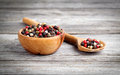 Colored Pepper in the wooden bowl Stock Images
