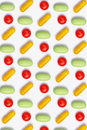 Colored pills arranged in row - pattern Royalty Free Stock Photo