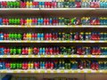 Colored plastic bottles for sales at Jumbo store Royalty Free Stock Photo