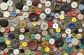 Colored plastic buttons on brown wooden background Royalty Free Stock Photo