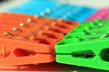 Colored plastic clothes pegs Royalty Free Stock Image