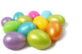 Colored plastic eggs egg shapes in white background Stock Images
