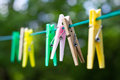 Colored plastic and wooden clothes pegs Royalty Free Stock Photo