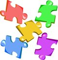 Colored puzzle colorful pieces of kids Stock Photography