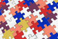 Colored puzzle with white Royalty Free Stock Photo