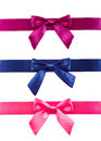 Colored ribbons with bows on white background. Stock Images