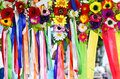Colored ribbons with flowers close up Royalty Free Stock Photos