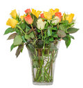 Colored rose flowers in a transparent vase, floral arrangement, isolated, white background Royalty Free Stock Photo
