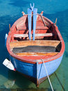Colored rowboat in clear sea. Royalty Free Stock Images