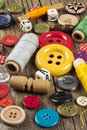 Colored sewing buttons on wooden background set of Stock Images