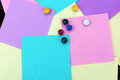 Colored sheets of paper and buttons Royalty Free Stock Photo