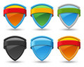 Colored shields with ribbon. Stock Photography