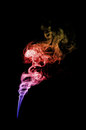 Colored smoke in black background isolated on blue pink red and orange Stock Photos
