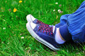 Colored sneakers in the grass Royalty Free Stock Image