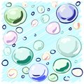 Colored soap bubbles hand-drawn on a blue background for your design. Royalty Free Stock Photo