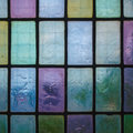 Colored stained glass window with regular block pattern blue green tone Royalty Free Stock Photo
