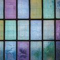 Colored stained glass window with regular block pattern blue green tone Royalty Free Stock Photography