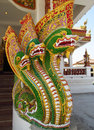 Colored statue of a green dragon in the buddist temple front entrance to with ornament and decorations Royalty Free Stock Photos
