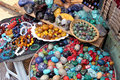 Colored stones for beads on the market Stock Photos