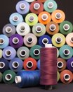 Colored thread for sewing. Threads in spools Royalty Free Stock Photo