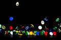 Colored thumbtack jumping on a dark background Royalty Free Stock Photos