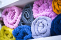 Colored towels in bathroom well packed Royalty Free Stock Photo