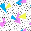 COLORED TRIANGLE MEMPHIS STYLE SEAMLESS PATTERN. GEOMETRIC ELEMENTS TEXTURE. 80S-90S DESIGN ON WHITE BACKGROUND.
