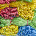 Colored twine in a street market in vietnam Stock Photo