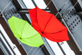 Colored umbrellas abstract red and green two hanged from an industrial ceiling Royalty Free Stock Photography