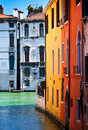 Colored venice street of with buildings and bridges Stock Images