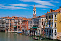 Colored venice street of with buildings and gondolas Royalty Free Stock Photos