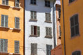 Colored walls and windows in the french city provence Stock Images