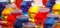 Colored water in bowls grouping of fish Stock Image