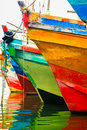 Colored water reflections . Colorful boats in the seaport . Royalty Free Stock Photo