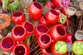 Colored wickerwork and colored poppy pods Stock Photos