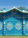 Colored wooden carved patterns on the old Russian gate close up