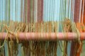 Colored wool thesis in ancient textiles weaving loom row of Royalty Free Stock Photo