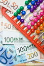 Colorful abacus and european money Royalty Free Stock Photos