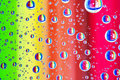Colorful abstract background of water drops on glass with rainbow colors Royalty Free Stock Photo